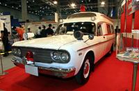 トミーテックのブースに飾られていた、1/1スケールのトヨタFS45V救急車。2代目クラウンのシャシーをストレッチして全長約5.6mもある特製ボディを架装し、大型トラックやランクル用の直6OHV4・エンジンを搭載した、昭和40年代の救急車の定番だったモデルである。