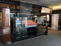 ルーツとなる「鈴木式織機製作所」の店舗を模したエントランス。