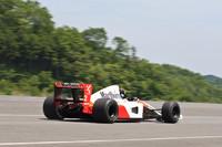 1991年シーズンを戦った「マクラーレン・ホンダMP4/6」。700ps以上を発生するV12DOHC48バルブ3498ccエンジンを搭載、第二期ホンダF1最後となるドライバーズ/コンストラクターズのダブルタイトルを獲得した。この個体はゲルハルト・ベルガーが同年の日本GPで優勝した(セナに勝利を譲られた)マシン。  (走行シーンが動画で見られます)