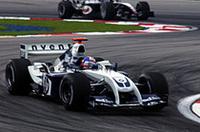 ルーベンス・バリケロにブロックされ、2位フィニッシュに甘んじたモントーヤは、フェラーリの戦術にご立腹の様子。「でもリタイヤよりは8点獲得のほうがいいからね」とはレース後の弁。(写真=BMW)