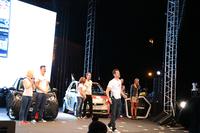 2015年の開催地はハンガリーのブダペストに決定。オーガナイザーたちは、ステージ途中でムスタッシュ(口ヒゲ)を付けて変装。会場を沸かせた。後方の「スマート」にルービックキューブが描かれているのは、その発明者がハンガリー人であるため。