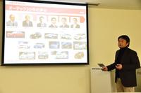 オーテックジャパンの歴史について紹介する、同社商品戦略部 部長の永澤清和氏。