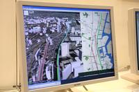「日立ソフトウェアエンジニアリング」のブースに展示されていた、平面と同時に3D画像でルートが表示されるカーナビ。将来的にはこうなるのかも。