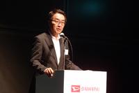ダイハツ工業の上田 亨 上級執行役員。発表会の席上、「ムーヴ キャンパス」を「次の100年に向けてスタートするためのクルマ」として紹介した。