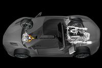 新型「NSX」のパワーユニットのレイアウト。同車の生産は、9段DCTや「ツインモーターユニット」などのエレクトリックデバイスは日本の浜松製作所で、エンジンは米オハイオ州のアンナ工場で、車両の組み立ては同州の「パフォーマンス・マニュファクチュアリング・センター」で行われる。