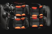これは、外板色ノアールオニキス(黒系)のクルマの内装。乗車定員は4名で、後部座席は左右独立したシート形状となる。5:5の分割可倒式。