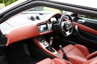 テスト車は、オプション「プレミアムパック」をセレクト。アームレストやドアポケットなど、内装の多くが本革張りとなり、その色も4種類から選べるようになる。写真は、パプリカ(赤)のインテリア。