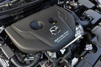 「XDツーリング」に搭載される1.5リッター直4ディーゼルエンジン。高価なNOx後処理システムなしで日本のポスト新長期規制をクリアする、高い環境性能を実現している。
