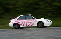 """STIによってチューンされた、スバル「インプレッサWRX STi spec C」。減衰力&車高調節式ダンパーや、ピロボールタイプのラテラル&トレーリングリンクを採用するなど、""""本気""""のチューンが施された1台である。"""