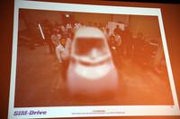 すでに開発中の第1号は2011年3月29日にお披露目される予定。今回の発表会場では、ぼかしを入れた写真が公開された。